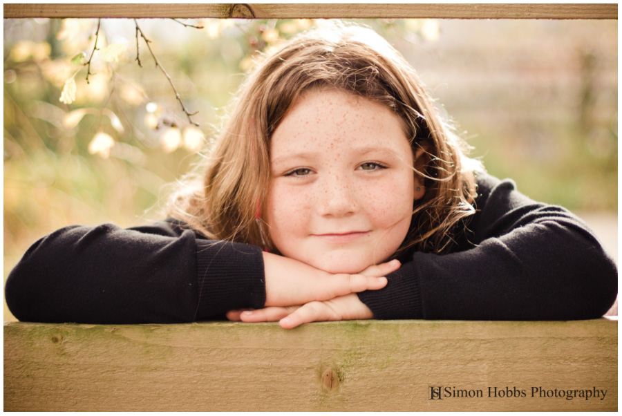06-Girl-Looking-Through-Fence-in-Derby