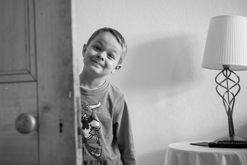 Boy Smiling by Door
