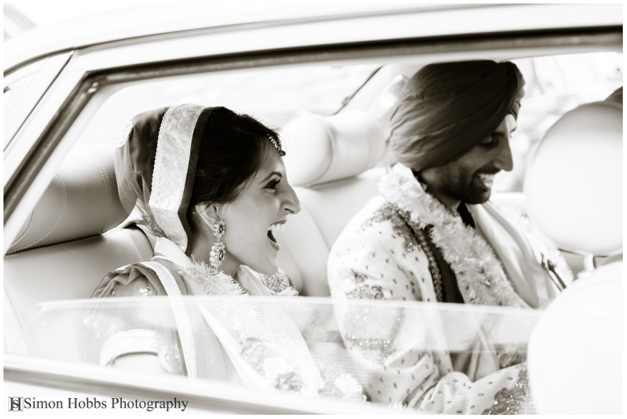19-Sikh-Wedding-Derby-Bride-And_Groom-In-Car